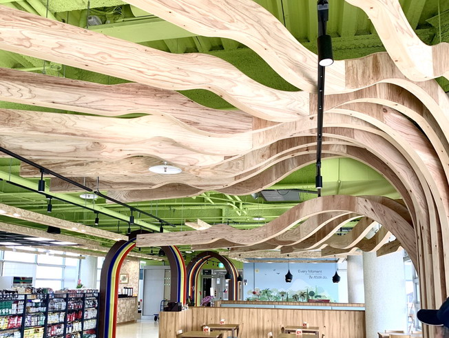 "The laminated veneer lumber (LVL) of domestic cedar showcased at ""Happy Tree Exhibition Space"" demonstrates obvious natural texture and geometric, parallel lines"