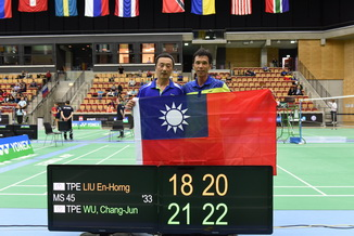 Wu Chang-Jun(right) won gold medals in the men's categories at the World Senior Badminton Championships in Helsinborg, Sweden.