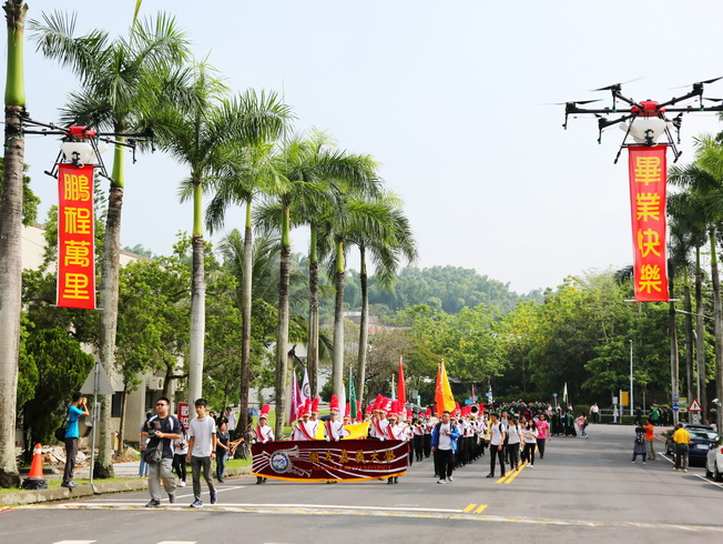 """At the NCYU graduation ceremony, the drones carried banners to wish """"All the success and bright future"""" and """"Happy commencement"""" to all the graduates."""