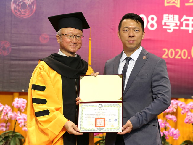 Huang Nan-Syong (right), General Manager of Shing Yan Co., Ltd., received the honorary doctoral degree certificate from NCYU President Chyung Ay (left) on the behalf of his father, Mr. Huang Zhang-Biao.